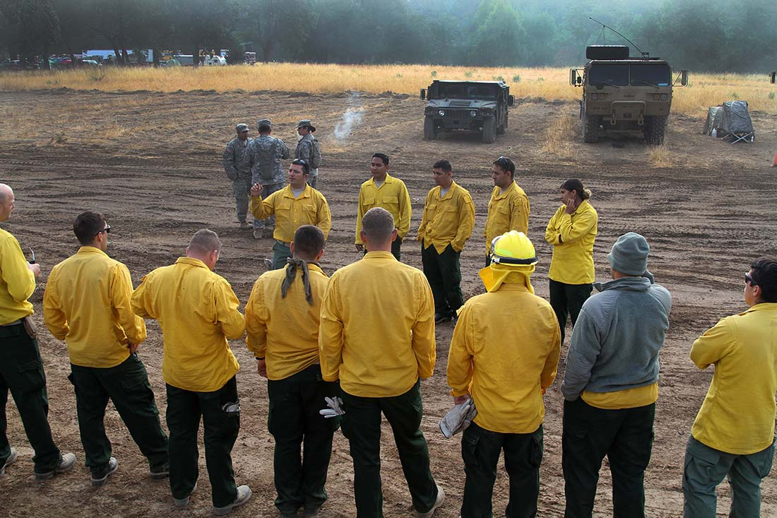 Soldiers from Task Force Alpha, California Army National Guard, conduct a morning brief Aug. 9 at Eel River Conservation Camp in Redway, California, prior to moving up the Humboldt mountains for mop up missions during the Humboldt Lightning Fire. (U.S. Army National Guard photo/Staff Sgt. Eddie Siguenza)